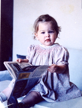At 15 months old, getting a head start on my book career.